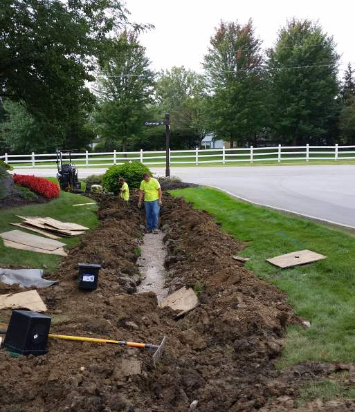 Working to remove an unsightly ditch