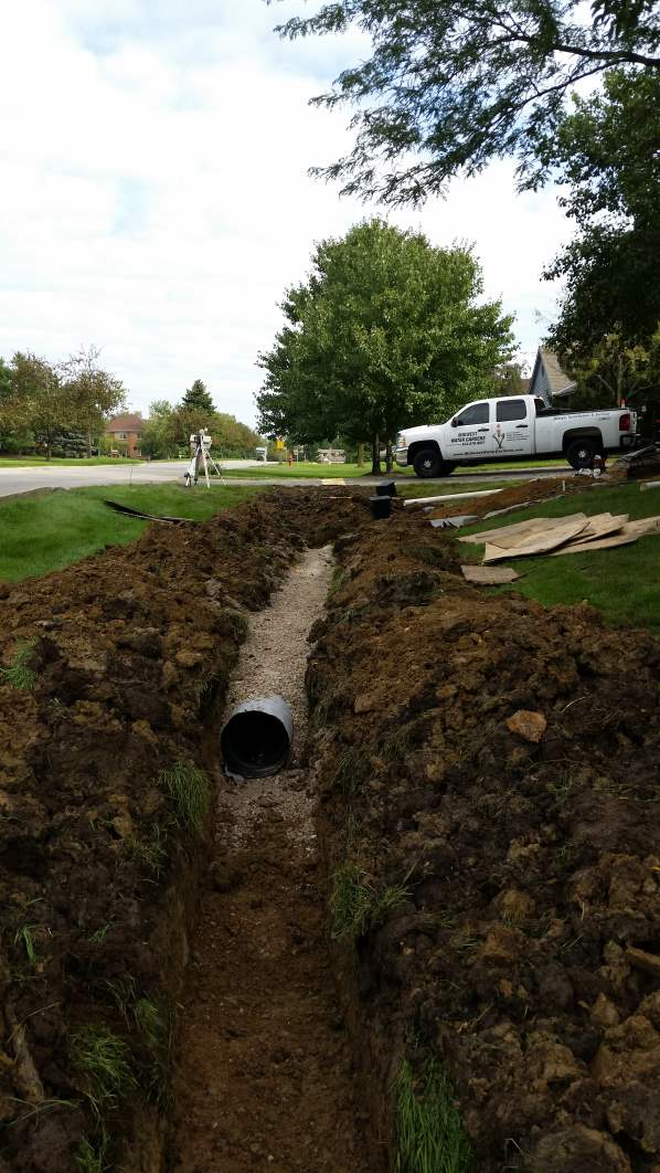 Large drain tile eliminates an unsightly ditch