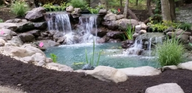 water feature with waterfall and koi pond
