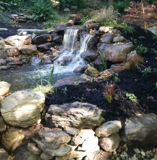 Beautiful landscaping with integrated waterfall