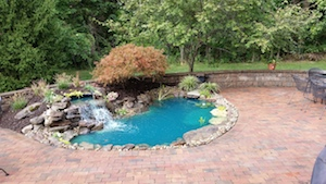 Paver patio with koi pond and waterfall